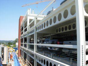 تقویت تیرآهن های لانه زنبوری به کمک رفتار مرکب بتن و فولاد